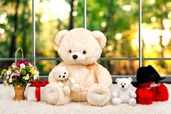 Teddy bears,a surprise gift and a basket of flowers on a background of the panoramic Windows. Teddy bears.Gifts and surprises.The world of soft toys royalty free stock image