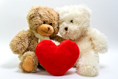 Teddy bears for Valentine's Day. Two teddy bears for Valentine's Day with big red heart Royalty Free Stock Images