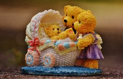 Teddy Bears Watching over Baby Teddy Bear Figurine Stock Photography