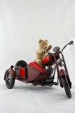 Teddy Biker. An old teddy bear on a vitage motrbike toy Royalty Free Stock Image