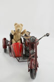 Teddy Biker. An old teddy bear on a vitage motrbike toy Stock Photography