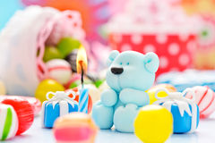 Teddy with candle and candy Royalty Free Stock Images
