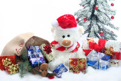 Teddy with Christmas presents Stock Image