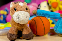 Teddy donkey in front of others baby toys Stock Images