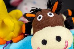 Teddy donkey beside other baby toys Stock Images
