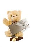 Teddy en gift Stock Foto's