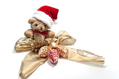 Teddy and a golden bow Stock Image