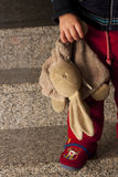 Teddy in the hands of a child. Detail of an old teddy in the hands of a Caucasian girl Royalty Free Stock Images
