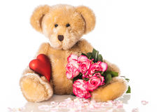 Teddy with heart and roses Stock Photography