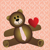 Teddy with heart on sleeve Stock Photography