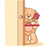 Teddy holding a breakfast tray with flowers Stock Photo