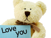 Teddy I love you. Front view of teddy bear toy with Love you note, isolated on white background Stock Images