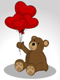 Teddy with love heart balloons Stock Image