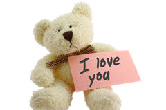 Teddy - loving. Front view of teddy bear toy with I love you note, isolated on white background Stock Photo