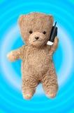 Teddy op de telefoon royalty-vrije stock foto's