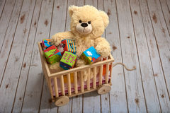 Teddy plays in the cart Royalty Free Stock Photos