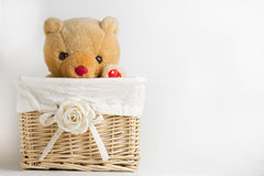 Teddy Plush in Wicker Basket Royalty Free Stock Photos
