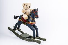 Teddy and rocking horse Stock Photos
