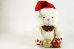Teddy with Santa Claus hat Royalty Free Stock Images