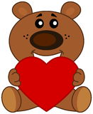 Teddy sat smiling with a heart Royalty Free Stock Photos