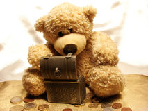Teddy & savings Stock Photo