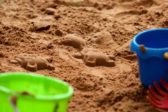 Teddy Shapes Made in Sand by a Child Stock Photos