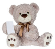 Teddy showing a message. Teddy Bear with message note pad for display Royalty Free Stock Photography