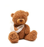 Teddy in sick. Isolated teddy bear with a broken arm Royalty Free Stock Photos