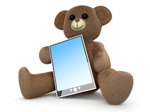 Teddy with a Tablet PC Royalty Free Stock Photo
