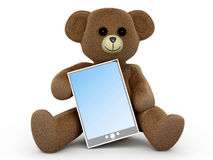 Teddy with a Tablet PC Stock Images