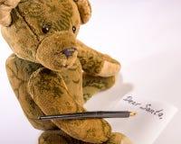 Teddy writing his wish list to Santa Claus Royalty Free Stock Photo