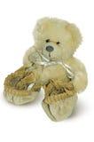 Teddybär in den beige Babyschuhen Lizenzfreie Stockfotos