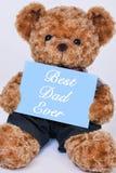 Teddybär, der das blaue Zeichen überhaupt sagt besten Vati hält Stockbild