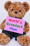 Teddybär, der das rosa Zeichen sagt Welt-` s größte Mutter hält Stockfotos