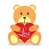 Teddybär, der ein großes rotes Herz hält Lizenzfreie Stockfotos