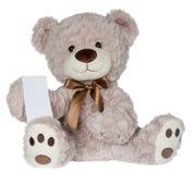 Teddybär, der eine Mitteilung zeigt Lizenzfreie Stockfotografie