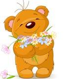 Teddybär, der einen Blumenstrauß gibt Stockbilder
