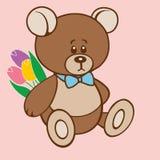 Teddybär, der einen Blumenstrauß von Tulpen hält Stockbild
