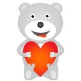 Teddybär, der rotes Herz hält Stockfotografie