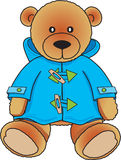 Teddybär im blauen Mantel Stockfoto