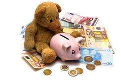 Teddybär im Geld Lizenzfreie Stockfotografie