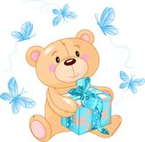 Teddybär mit blauem Geschenk Stockfotos
