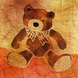 Teddybär mit einem Bogen Stockfotografie