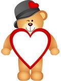 Teddybär mit geformtem Rahmen des Herzens Lizenzfreie Stockfotografie