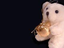 Teddybär mit Geschenk Stockfoto