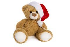Teddybär mit Santa Claus-Hut lokalisiert auf weißem Hintergrund Stockfoto
