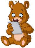Teddybär mit Tablette Lizenzfreies Stockbild