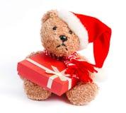 Teddybär mit Weihnachtsgeschenk Lizenzfreies Stockbild