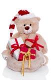 Teddybär-tragender Weihnachtshut mit den Geschenken lokalisiert auf weißem Ba Lizenzfreies Stockfoto