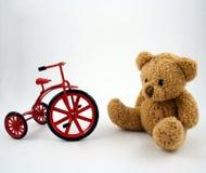 Teddybär und Dreirad Stockfoto